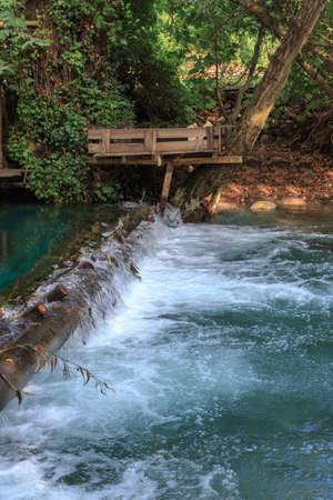 mugla: Small lake flowing like waterfall among big jungle trees in Yuvarlak Cay in Mugla. Stock Photo