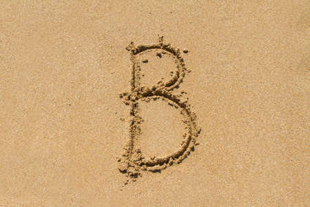 upper case: Letter B of the alphabet written on sand with upper case.