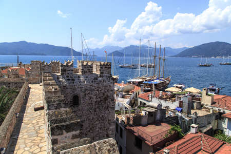 mugla: MUGLA, TURKEY - JUNE 1, 2015 : View of Marmaris town and marina from old historical Marmaris Tower, on blue sky background. Editorial