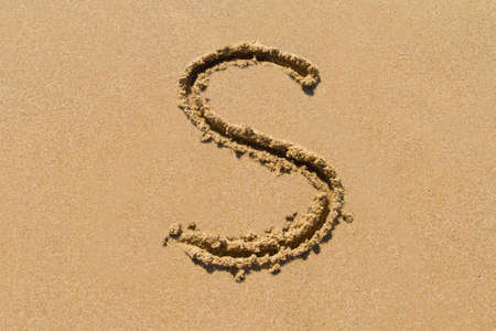 upper case: Letter S of the alphabet written on sand with upper case.