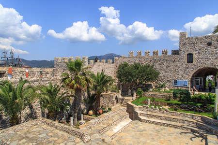 mugla: MUGLA, TURKEY - JUNE 1, 2015 : Inside view of high stone walls of historical old Marmaris Tower, on blue sky background.