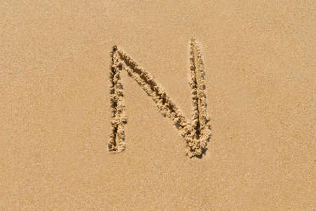 upper case: Letter N of the alphabet written on sand with upper case.