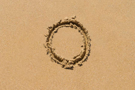 upper case: Letter O of the alphabet written on sand with upper case.