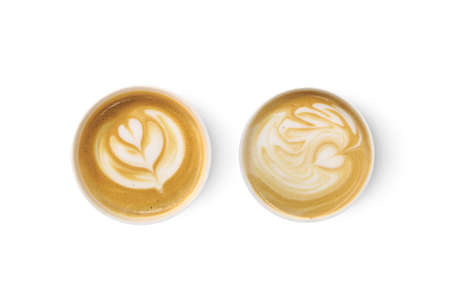 Top view of two latte art coffees with heart figure, isolated on white background.