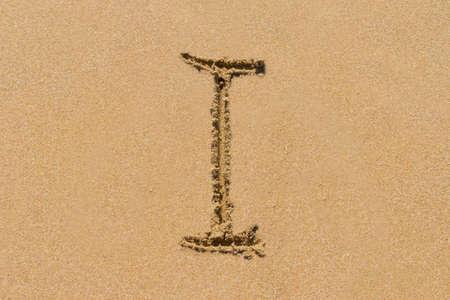 upper case: Letter I of the alphabet written on sand with upper case.