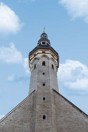 lutheran: Close up detailed bottom view of medieval Lutheran Church of the Holy Ghost in Tallinn, Estonia, on blue cloudy sky background.