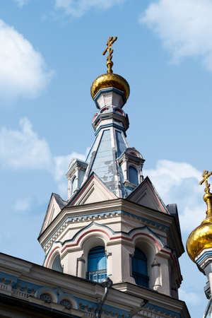 boris: Close up view of Orthodox Ss Boris and Gleb Cathedral in Dougavpils, Latvia, on blue cloudy sky background.