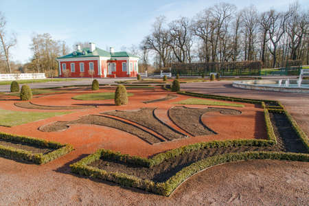 weed block: View of Kadriorg park with a small building, trees and meadow field in Tallinn, Estonia, on blue sky background.