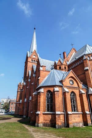evangelical: Side view of  Evangelical Lutheran Marthin Luther Cathedral in Dougavpils, Latvia, on cloudy blue sky background.