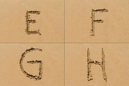 upper case: Conceptual set of E F G H letter of the alphabet written on sand with upper case.