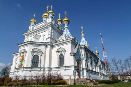 boris: Side view of Orthodox Ss Boris and Gleb Cathedral in Dougavpils, Latvia, main and the biggest orthodox church in Latvia, built in 1905, on blue sky background. Stock Photo
