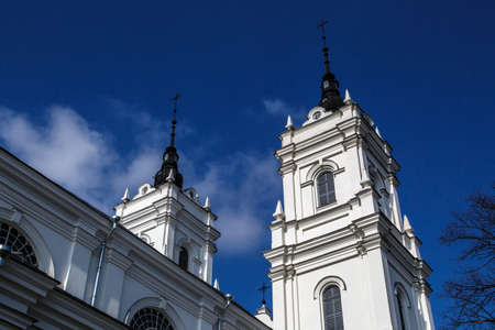 azul marino: Side view of the tower of Roman Catholic Cathedral in Ludza, Latvia, on navy blue sky background.