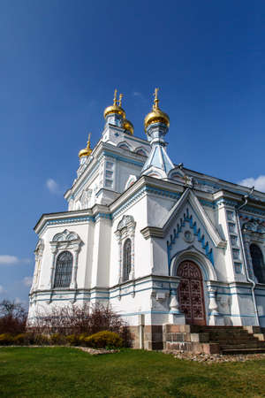 boris: Side view of Orthodox Ss Boris and Gleb Cathedral in Dougavpils, Latvia, on blue cloudy sky background. Stock Photo
