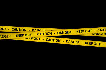 keep out: Yellow caution tape strips with text of keep out, danger and caution, on black background.