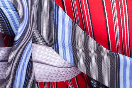 detailed view: Close up detailed view of multicolored striped and checkered men ties as background.