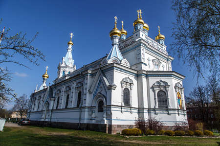 boris: DOUGAVPILS, LATVIA - APRIL 28, 2015 : Side view of Orthodox Ss Boris and Gleb Cathedral in Dougavpils, Latvia, main and the biggest orthodox church in Latvia, built in 1905, on blue sky background. Editorial