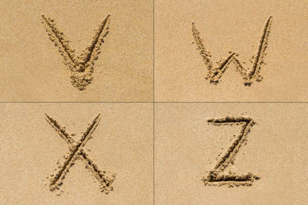 upper case: Conceptual set of V W X Z letter of the alphabet written on sand with upper case. Stock Photo