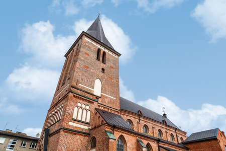 14th century: View of Evangelist Lutheran St Johns Church in Tartu, Estonia from the 14th century, on coludy blue sky bakcground.