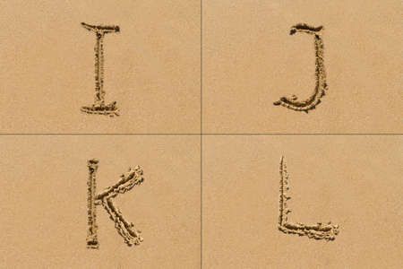 concepts alphabet: Conceptual set of I J K L letter of the alphabet written on sand with upper case.