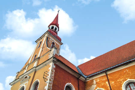 lutheran: Side view of Lutheran  St. Elizabeth Church in Parnu, Estonia, on cloudy sky background. Stock Photo