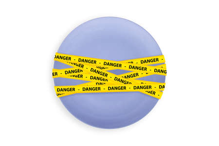 caution tape: Yellow caution tape strips with text of danger on a blue ball, isolated on white background.