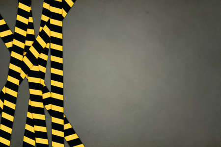 striped band: Yellow and black striped caution bands, on grey background.