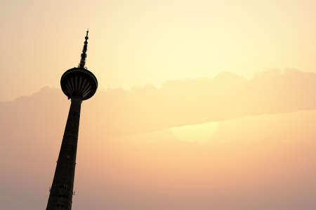 buttom: Buttom view of Tv Tower with 60m of altitude, in Tallinn Estonia, on sunrise or sunset background.