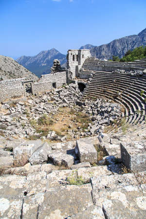 Top view of amphitheater of Termessos Antique City in Antalya, on bright blue sky background. Banco de Imagens