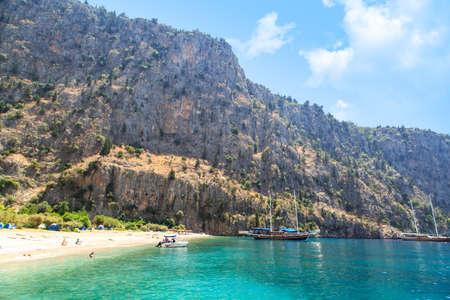 fethiye: FETHIYE, MUGLA - JULY 17, 2015 : Butterfly Valley, natural cove of Fethiye famous with big butterflies, seascape with boats and people in the sea.