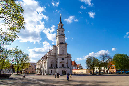 town hall square: KAUNAS, LITHUANIA - APRIL 30, 2015 : Front view of Town Hall building in town hall square of Kaunas old town, Lithuania, built in 16th century, on cloudy blue sky background. Editorial