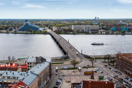 hanging around: RIGA, LATVIA - MAY 2, 2015 : Top view of a square with buildings around where people are hanging around on the coastline of Daugava river, in Riga Latvia.