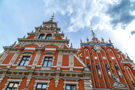mentioned: RIGA, LATVIA - MAY 2, 2015 : Close up bottom view of House of Blackheads which was first mentioned in 13th century, destroyed during world war II and restored in 2000 after Latvias independence.