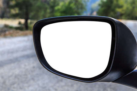 Close up front view of rearview mirror of a car with blank copy space, on road scene background.
