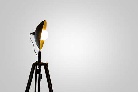 side lighting: Close up side view of spotlight lighting with bright white bulb, on white background. Stock Photo