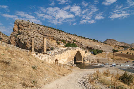 severus: ADIYAMAN, TURKEY - AUGUST 24, 2015 : View of ancient historical Cendere Bridge, built in about 200 AC for Roma Imperiur Septimus Severus in Adiyaman. Stock Photo
