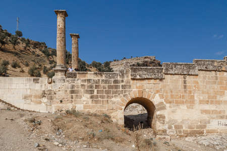 severus: ADIYAMAN, TURKEY - AUGUST 24, 2015 : View of ancient historical Cendere Bridge, built in about 200 AC for Roma Imperiur Septimus Severus in Adiyaman. Editorial