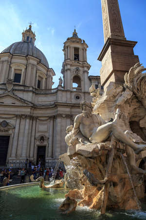 hanging around: ROME, ITALY - SEPTEMBER 23, 2015 : Close up detaled view of Piazza Navona, with pleople hanging around the fountain with scuptures, on bright blue weather background.