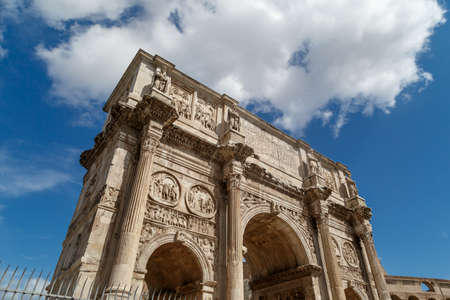 constantine: View of historical Triumphal Arch of Constantine, built in 315 AD in Rome, on cloudy blue sky background. Stock Photo