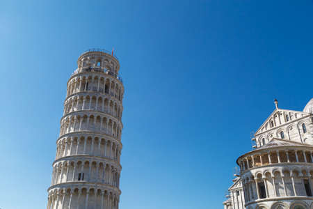 pisa tower: View of historical Pisa Tower in Cathedral Square of Pisa, Italy, on bright blue sky background. Stock Photo
