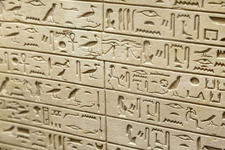 hieroglyphic: FLORENCE, ITALY - SEPTEMBER 20, 2015 : Close up detailed view of egyptian tablet inscriptions with hieroglyphic signs exhibited in Florence Archeology Museum. Editorial