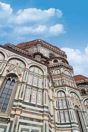 santa maria del fiore: Bottom view of famous historical Florence Duomo, Santa Maria Del Fiore, on cloudy blue sky background.