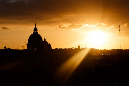 spanish steps: View of Rome from Spanish Steps with silhouette buildings on sunset time background.