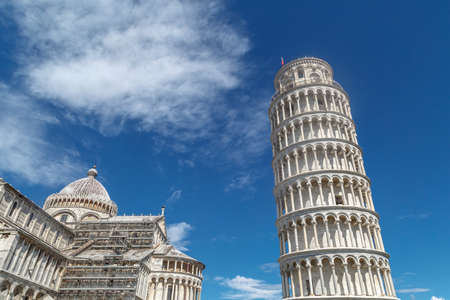pisa tower: View of historical Pisa Tower in Cathedral Square of Pisa, Italy, on cloudy blue sky background. Stock Photo