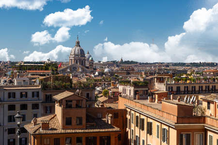 spanish steps: View of Rome with historical buildings from Spanish Steps, on cloudy blue sky background.