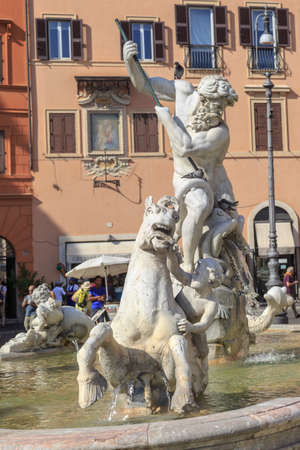 hanging around: ROME, ITALY - SEPTEMBER 23, 2015 : Close up detaled view of Piazza Navona, with pleople hanging around the historical fountain with scuptures. Editorial