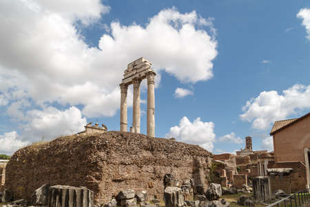 archeological: View of archeological area of ancient Roman Forum in Rome, on cloudy blue sky background.
