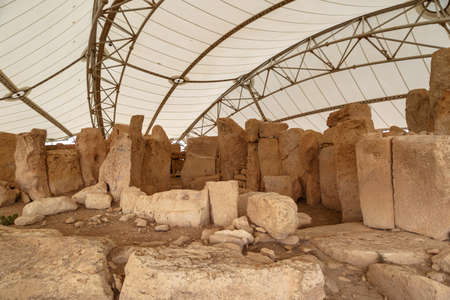 tent city: General view of ancient limestone structures of Hagar Qim and Gnajdra Temples in Qrendi, Malta.