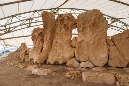 tent city: Detailed view of ancient limestone structures of Hagar Qim and Gnajdra Temples in Qrendi, Malta.