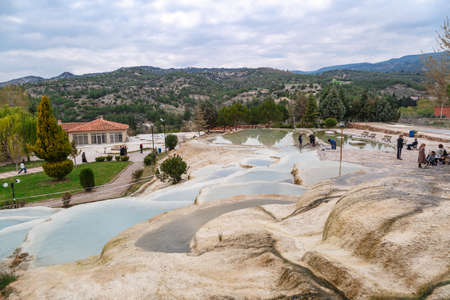 geographical: View of natural geographical formations in Pamukkale area in Turkey with travertine pools.