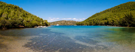 mugla: MUGLA, TURKEY - MAY 28, 2016 : Landscape view of Bodrum Heaven Cove with brillant sea coast and hills with green trees. Editorial